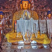 A Tibetan Buddhist sculptures adorn a Gompa (monastery) in Braga, Nepal.