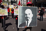 Lenin poster. Demonstration by unions and other organisations of workers to mark the annual May Day or Labour Day. Groups from all nationalities from around the World, living in London gathered to march to a rally in central London, UK.