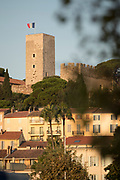 Musee de La Castre and medieval tower of Cannes with French flag, Cannes, France.