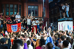 © Licensed to London News Pictures . 03/07/2021. Manchester, UK. English football fans and revellers celebrate a decisive England victory against Ukraine as hundreds take part in an impromptu party taking place in Stevenson Square , in the Northern Quarter of Manchester City Centre . Photo credit: Joel Goodman/LNP