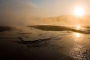 Sunrise at The Grand Prismatic Spring in the Midway Geyser Basin of Yellowstone National Park, Wyoming.