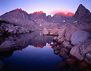 Mt. Agassiz, Mt. Winchell, Thunderbolt Peak, North Palisade and Isosceles Peak reflected at sunset in one of the Dusy Lakes, Dusy Basin, Kings Canyon National Park, California.