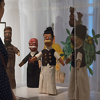 Visitors watch puppets seen on display at a puppet exhibition in the Petofi Literature Museum in Budapest, Hungary on Sept. 6, 2018. ATTILA VOLGYI
