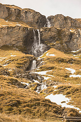 Low angle view of waterfall, Grossglockner, Austrian Alps Carinthia, Austria