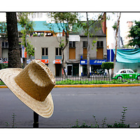 View of Hat, road & Green taxi; <br />