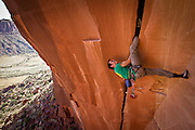 British Rock Climber on 'Belly Full of Bad Berries' in Indian Creek, Utah, USA