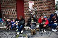 """Every Sunday Rev.Lee Anne Reat hold a church service on the corner of Central Ave and Broad street. Each week dozens of people living in the """"Bottoms"""" gather for prayer and food."""