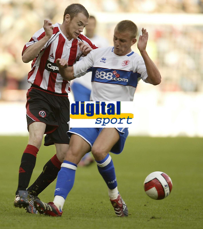 Photo: Aidan Ellis.<br /> Sheffield United v Middlesbrough. The Barclays Premiership. 30/09/2006.<br /> Sheffield's Alan Quinn (L) battles with Boro's Lee Catermole