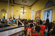 Police inside their station on Royal Street in New Orleans French Quarter do nothing as protesters take over the lobby and hold an impromptu rally after a vigil for Mark Brown.