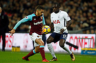 Manuel Lanzini of West Ham United (L) dispossesses Moussa Sissoko of Tottenham Hotspur (R).  Premier league match, Tottenham Hotspur v West Ham United at Wembley Stadium in London on Thursday  4th January 2018.<br /> pic by Steffan Bowen, Andrew Orchard sports photography.