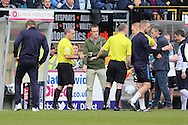 Referee Brendan Malone debating with his third official on whether or not  to award the goal to Lyle Taylor of AFC Wimbledon. Skybet football league two match, Wycombe Wanderers  v AFC Wimbledon at Adams Park  in High Wycombe, Buckinghamshire on Saturday 2nd April 2016.<br /> pic by John Patrick Fletcher, Andrew Orchard sports photography.