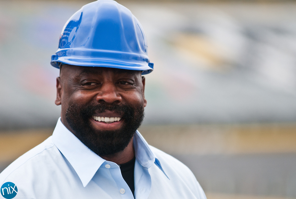 """Former Dallas Cowboy Ed """"Too Tal"""" Jones during a topping out ceremony for the steel frame that will support a high-definition video board at Charlotte Motor Speedway Thursday morning. The 200-foot wide, 80-foot tall video board will debut during the track's race events in May.  (Photo by James Nix)"""