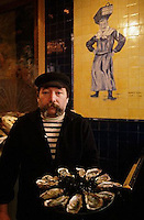 French Oysterman in Paris Restaurant --- Image by © Owen Franken