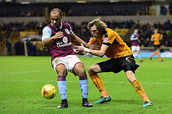 Gabriel Agbonlahor of Aston Villa keeps hold of the ball under pressure from Richard Stearman of Wolverhampton Wanderers - Mandatory by-line: Dougie Allward/JMP - 14/01/2017 - FOOTBALL - Molineux - Wolverhampton, England - Wolverhampton Wanderers v Aston Villa - Sky Bet Championship