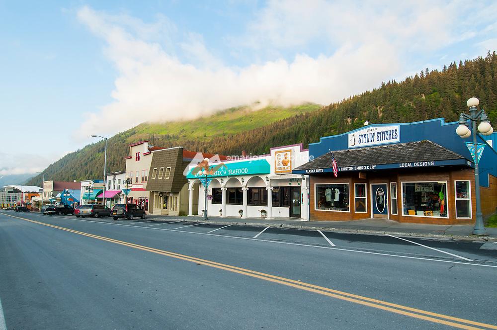 Colorful shops line the street. Morning in downtown Seward, Alaska.