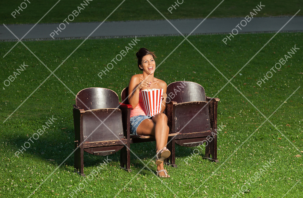portrait of a girl with popcorn in to the summer cinema