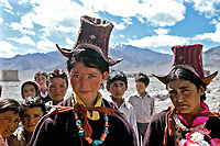 Women seen in Ladakh, India wearing traditional dress and Perak hats. Photograph by Jayne Fincher