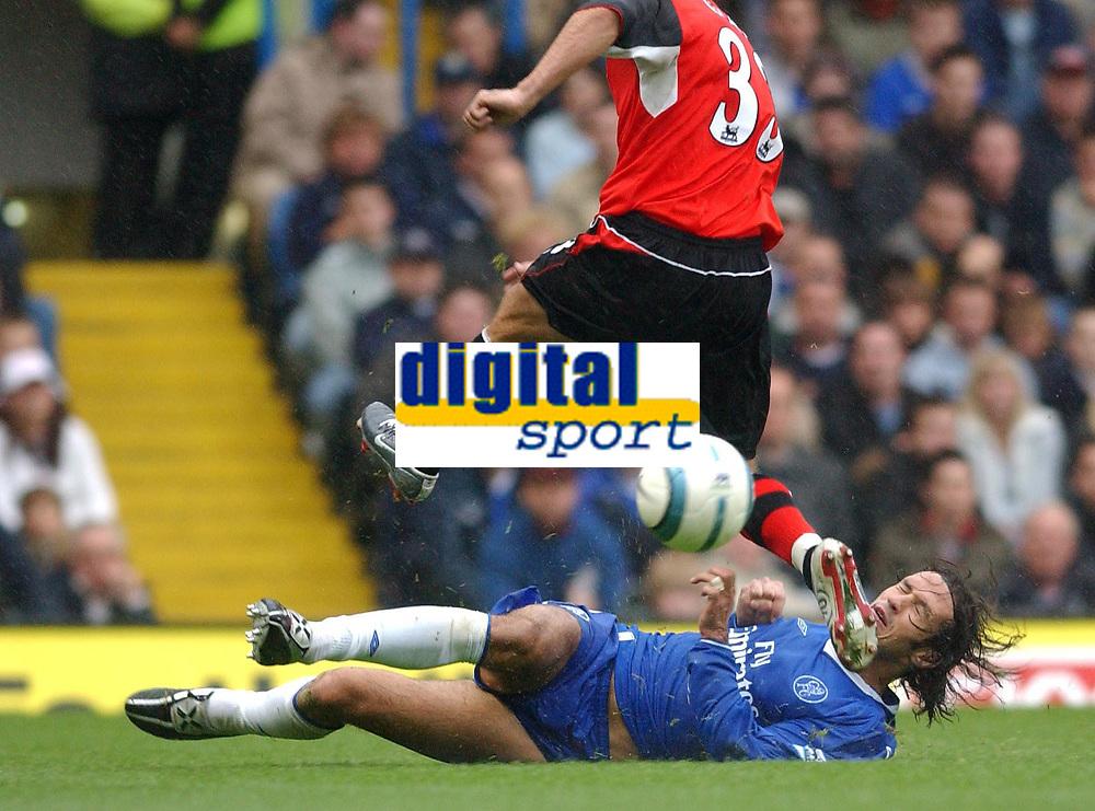 Photo. Daniel Hambury.Digitalsport<br /> Barclays Premiership.<br /> Chelsea v Blackburn Rovers. 23/10/2004.<br /> Chelsea's Smertin goes in where it hurts