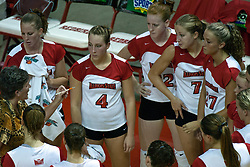 19 AUG 2006  The Redbirds huddle up around coach Sharon Dingman during a time out.  Northern Illinois Huskies got slammed by Illinois State Redbirds, losing the match 3 games to 1. Game action took place at Redbird Arena on the campus of Illinois State University in Normal Illinois.