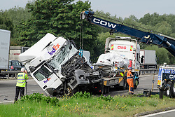 © Licensed to London News Pictures. FILE PICTURE. 26/08/2017. Damage to a lorry on the M1 motorway near Newport Pagnell following a crash involving a minibus and two lorries. The trial of Ryszard Masierak and David Wagstaff is due to start at Reading Crown Court today (Thurs). The pair are accused of causing death by dangerous driving of six men and two women who were traveling in a minibus near Newport Pagnell on 26 August. Photo credit: Ben Cawthra/LNP