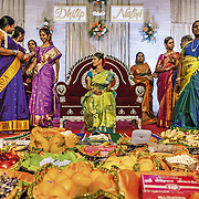 The South Indian bride, adorned in a fine silk Kanchipuram saree, accepts the gifts brought for the engagement ceremony by the women relatives of the groom in Madurai. <br /> Tamil Nadu, 2009