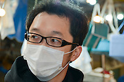 Portrait of a Japanes man with surgical mask Photographed in Tokyo, Japan