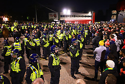 © Licensed to London News Pictures. 24/10/2021. Manchester, UK. Police mount a large operation to separate rival fans, after the match . Football fans outside Old Trafford ahead of a Premier League tie between Manchester United and Liverpool . Photo credit: Joel Goodman/LNP