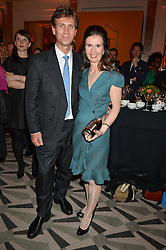 Left to right, KATHERINE GARRETT-COX winner of the Veuve Clicquot Business Woman of The Year and her husband JEREMY at the Veuve Clicquot Business Woman Awards held at Claridge's, Brook Street, London on 11th May 2015.