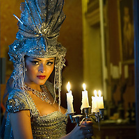 VENICE, ITALY - MARCH 05:  A woman carries a candles holder at Palazzo Pisani Moretta during the annual Ballo del Doge on March 5, 2011 in Venice, Italy. The Ballo del Doge, created by fashion and costume designer Antonia Sautter, is considered the most elegant and exclusive masquerade ball during the Venice Carnival.
