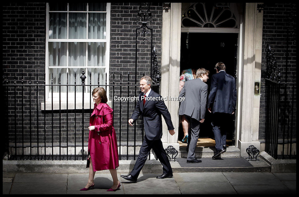 Tony Blair and his wife Cherie  leave Downing st  as their children go back inside  as he stands down as PM.PRESS ASSOCIATION Photo. Picture date:Wednesday 27th June  , 2007. Photo credit should read: Andrew Parsons/PA.