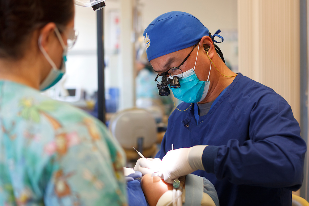 Peter Chiang, D.D.S., treats a patient Tuesday, Dec. 13, 2011, at Central Coast Pediatric Dental Group in Salinas, California.