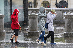 © Licensed to London News Pictures. 27/09/2019. London, UK. People covers her heads during heavy downpour in London. According to the Met Office, this weekend is set to be washout with over 2o hours of rainfall in the capital. Photo credit: Dinendra Haria/LNP. Photo credit: Dinendra Haria/LNP