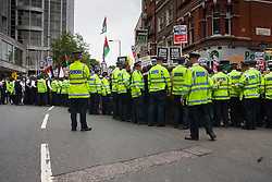 """London, July 5th 2014. Police struggle to contain crowdsas hundreds protest near the Israeli embassy in London against the ongoing occupation of Palestine and the west's support of """"Israel's collective punishment of Palestinians""""."""