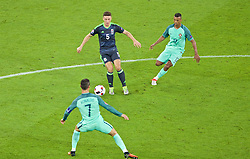 LYON, FRANCE - Wednesday, July 6, 2016: Wales' James Chester in action against Portugal's captain Cristiano Ronaldo and Luís Carlos Almeida da Cunha 'Nani' during the UEFA Euro 2016 Championship Semi-Final match at the Stade de Lyon. (Pic by Paul Greenwood/Propaganda)