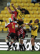 Hurricanes no 8 Victor Vito is beaten to the ball by Franco Van Der Merwe. Super 15 rugby match - Hurricanes v Lions at Westpac Stadium, Wellington, New Zealand on Saturday, 4 June 2011. Photo: Dave Lintott / photosport.co.nz