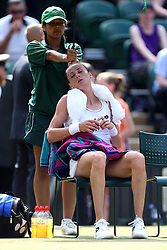 Magdalena Rybarikova cools down with an ice towel during her match against Karolina Pliskova on day four of the Wimbledon Championships at The All England Lawn Tennis and Croquet Club, Wimbledon.