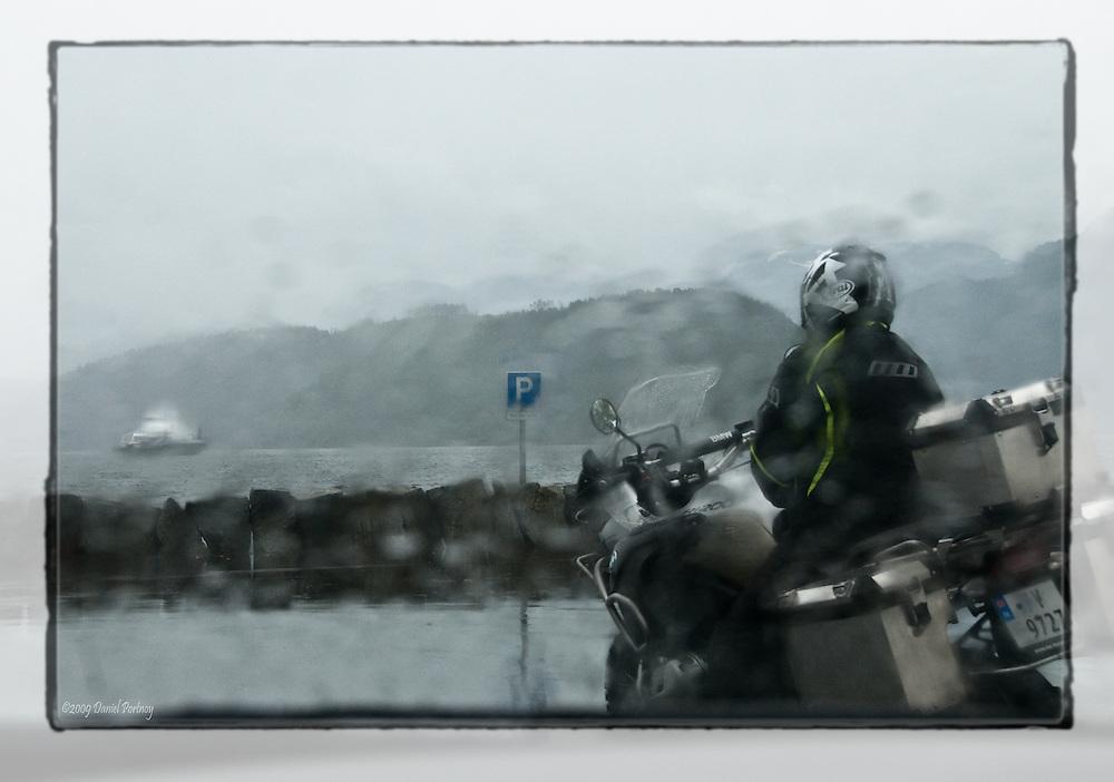 Raining - view through car window.