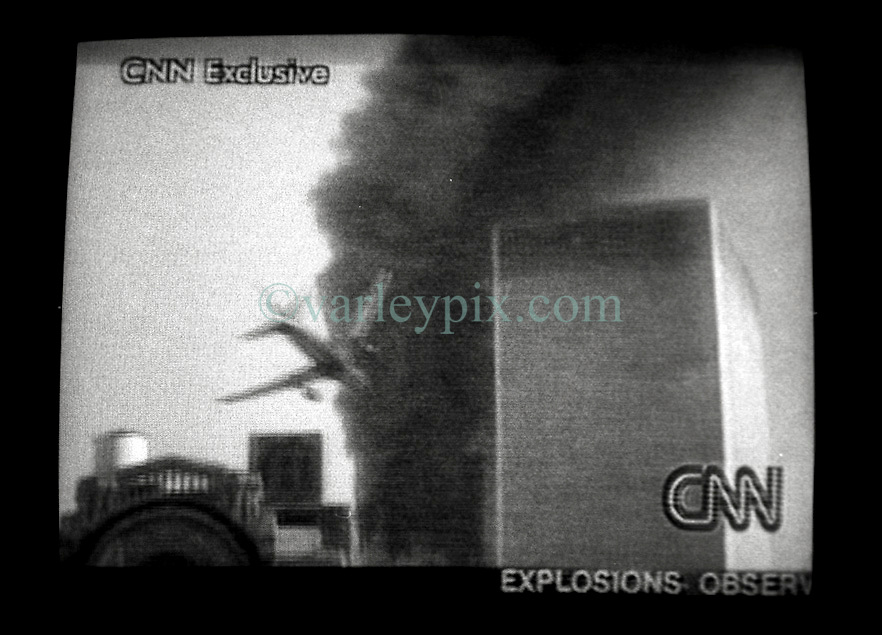 11 Sept 01. Twin Towers World Trade Center, New York City, NY.<br /> A CNN screen grab from the fateful morning of September 11th, 2001 moments before Al Qaeda terrorists flew a second hijacked plane into the south tower of World Trade center. United Airlines Flight 175 is believed to be the plane that hit the World Trade Center's South Tower. It was a Boeing 767-222 on a scheduled flight from Boston to Los Angeles, with 56 passengers, 7 flight attendants, and 2 pilots.<br /> Photo credit©; Charlie Varley/varleypix.com.