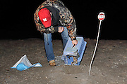U.S. Forest Service biologist, Randy Griebel, releases an endangered Black-footed ferret back to the burrow where it was trapped, near Wall, Soouth Dakota.