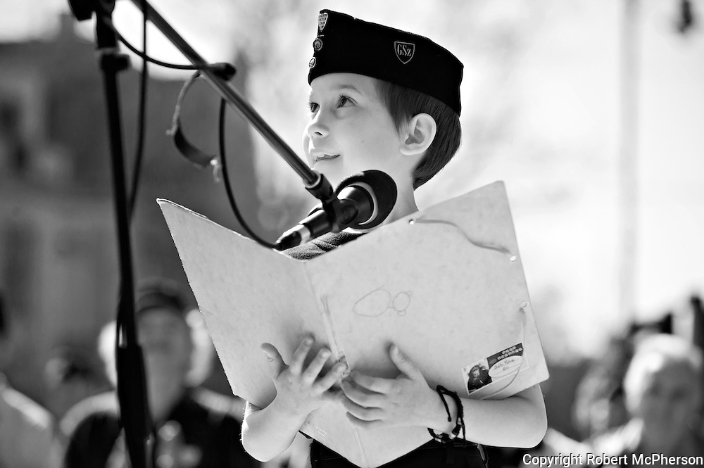"""A young boy who is a member of """"The Hungarian Guard"""". By western media they are usually defined as a paramilitary organization. The Hungarian Guard have more than thousand members and is associated with the government party Jobbic. The president of """"The Hungarian Guard"""" was Gábor Vona who today is the leader of the third largest party in the government called Jobbic. Jobbic is a right-wing extremist government party."""