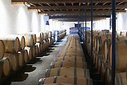 barrel aging cellar chateau le boscq st estephe medoc bordeaux france