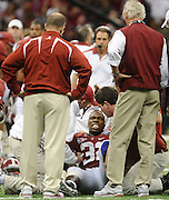 Daily Photo by Gary Cosby Jr.    ..CJ Mosley grimaces in pain as he is treated on the field for what appeared to be a serious leg injury during the second half of the BCS National Championship Game between Alabama and LSU in the Superdome Monday night...................................