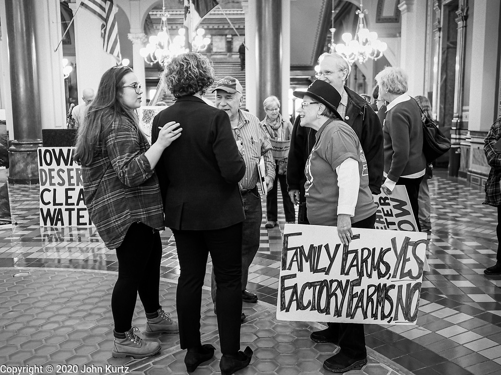 23 JANUARY 2020 - DES MOINES, IOWA: People talk to Iowa State Senator CLAIRE CELSI (D), center, back to camera, before a rally in the Iowa State Capitol against factory farming. About 75 people, including farmers, environmental activists, and supporters of family farms, came to a protest in the rotunda of the state capitol in Des Moines. They are trying to pressure Iowa lawmakers to pass a moratorium against new factory farm construction in Iowa.      PHOTO BY JACK KURTZ