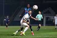 Stockport County defender Liam Hogan (4) head back the ball to team-mate (not included in the picture) during the The FA Cup match between Rochdale and Stockport County at the Crown Oil Arena, Rochdale, England on 7 November 2020.