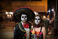 """Johnson City, TN - October 29, 2016: Martin and Jenna wear customes on Halloween weekend in downtown Johnson City, TN. Their costumes — bad hombre and nasty woman — were a play on the third presidential debate, held on October 19, in which Trump used the phrases """"bad hombre"""" and """"nasty woman""""."""