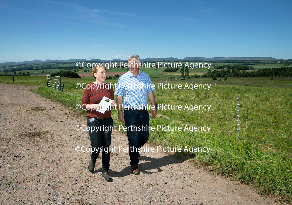 Quality Meat Scotland (QMS) Better Grazing meeting at Newmiln Farm, Tibbermore, Perth<br />Poppy Frater from SAC and Farmer Hugh Grierson<br />Picture by Graeme Hart.<br />Copyright Perthshire Picture Agency<br />Tel: 01738 623350  Mobile: 07990 594431