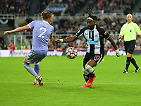 NEWCASTLE UPON TYNE, ENGLAND - SEPTEMBER 17: Allan Saint-Maximin of Newcastle United skips past Luke Ayling of Leeds United during the Premier League match between Newcastle United and Leeds United at St. James Park on September 17, 2021 in Newcastle upon Tyne, England. (Photo by MB Media)