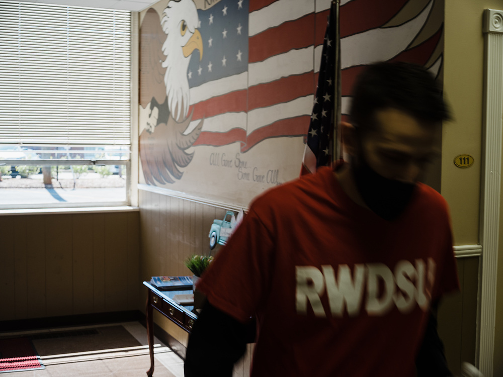 BIRMINGHAM, AL – MARCH 20, 2021: Lead union organizer Joshua Brewer walks through the RWDSU Union Hall in Birmingham's Southside, where Amazon employees are organizing for the Retail Wholesale and Department Store Union. If union organizers are successful, the BHM1 fulfillment center in Bessemer will become the first unionized Amazon warehouse in the country. CREDIT: Bob Miller for Le Monde