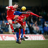 Chesterfield attacker Wayne Allison sandwiched between two Forest defenders