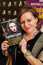 "© Licensed to London News Pictures. 20/02/2016<br /> Kimberley Chambers with her new book "" Tainted Love"".<br /> Crime ficton author Kimberley Chambers at Waterstones book store Bluewater,Greenhithe,Kent.<br />  (Byline:Grant FalveyLNP)"